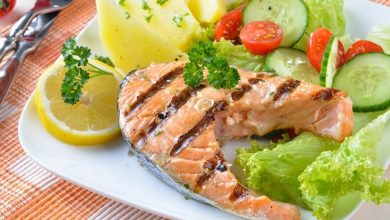 Grilled salmon steak with potatoes and salad